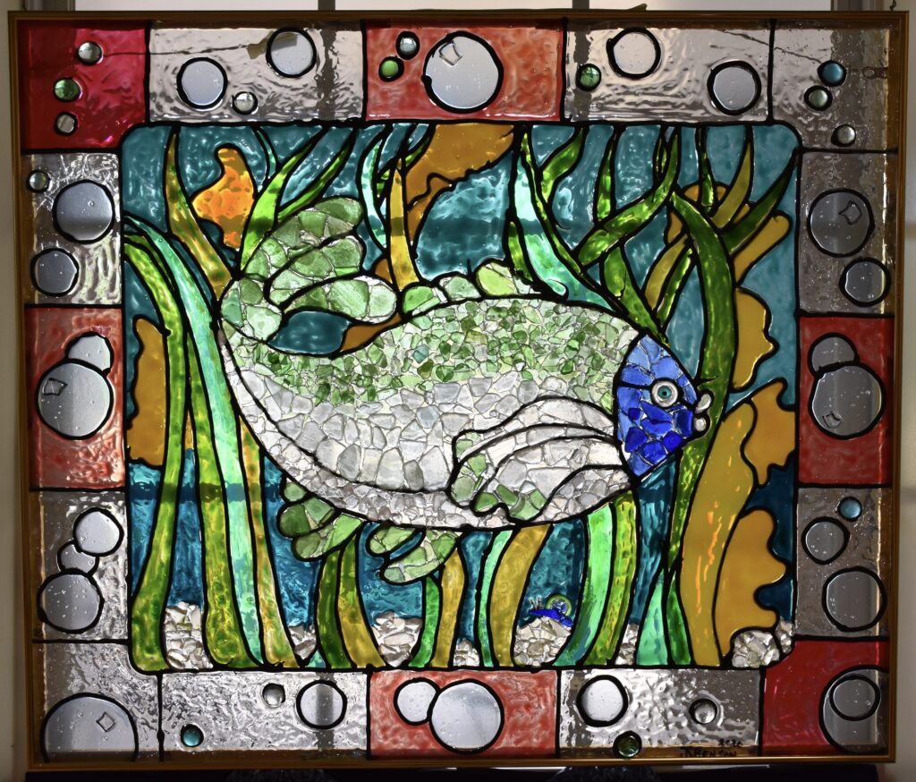 A combination of stained-glass paint and sea glass collected from local beaches.