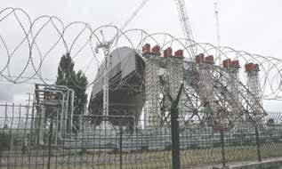 A gigantic steel arch under construction to cover the remnants of the exploded reactor at the Chernobyl nuclear power plant, in Chernobyl, Ukraine, on Sunday, Aug. 25, 2013, the scene of the world's worst nuclear accident. The No. 4 reactor at Chernobyl nuclear power plant was the scene of a major explosion in 1986, resulting in the evacuation of the nearby town and the ongoing legacy of protecting against any possible radiation leaks. (AP Photo/Efrem Lukatsky)