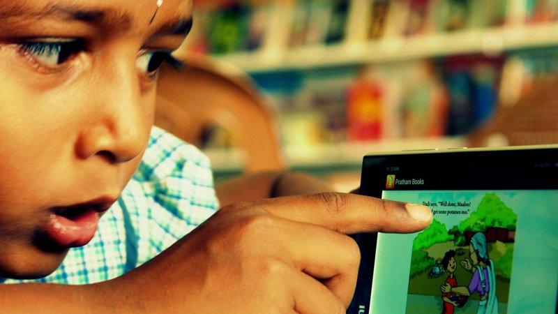 A child reads a book on the StoryWeaver platform. (Photo: Pratham Books)