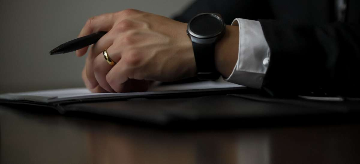 Close up of a man's hand and wrist wearing a watch