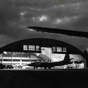 Black and white photo of an airplane hanger