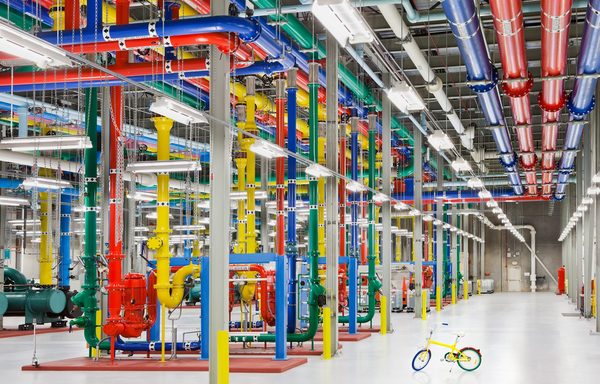 Colorful pipes and a yellow bike inside Google Cloud Platform's data center.