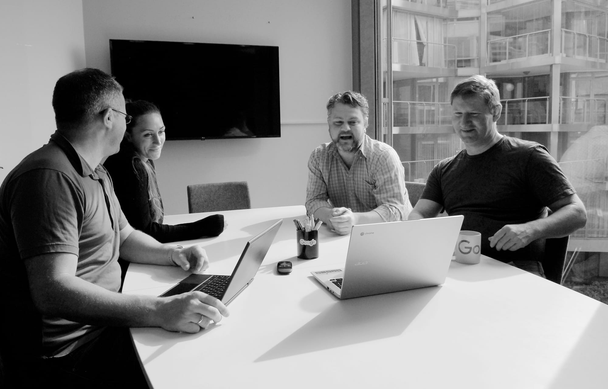 Four employees of The Cloud People in a meeting.