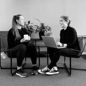 Two girls chatting.