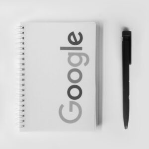 Google notebook and pen.