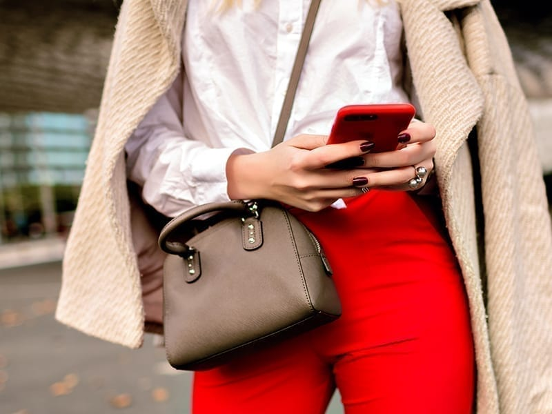 woman wearing sling bag
