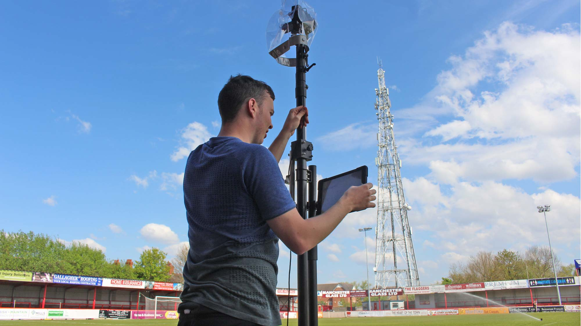Jack Heggie setting up the Vantage Point camera mast at a soccer stadium