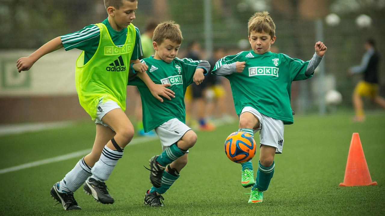 Soccer players challenging for the ball