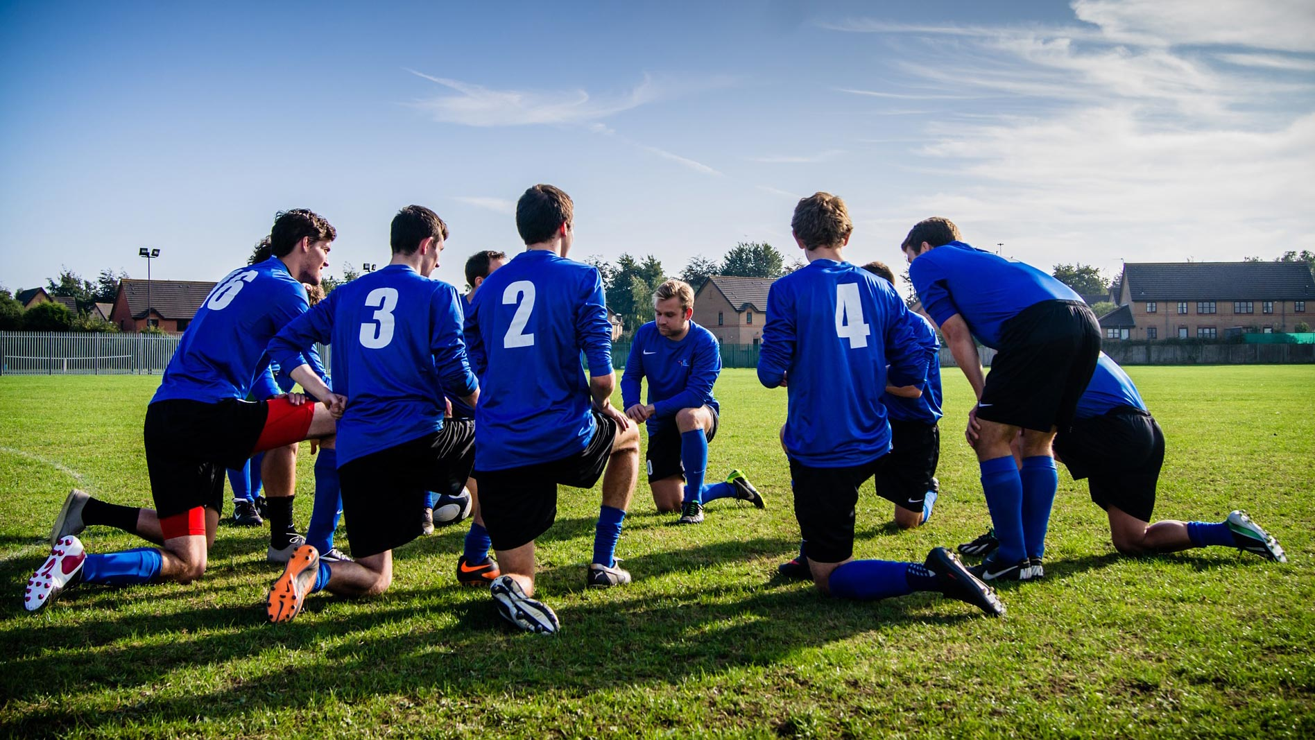 Soccer team huddling for a team talk