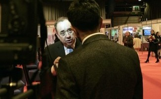 First Minister Alex Salmond chats to a TV crew after his speech at the Gathering