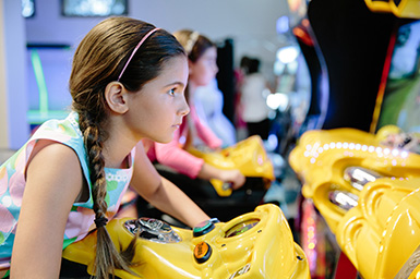 A girl playing an arcade game