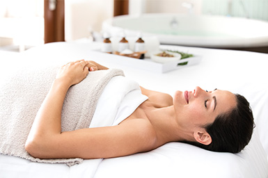Woman on massage bed