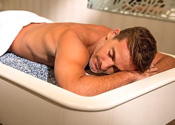 Man on massage bed