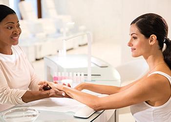 Two women in manicure station