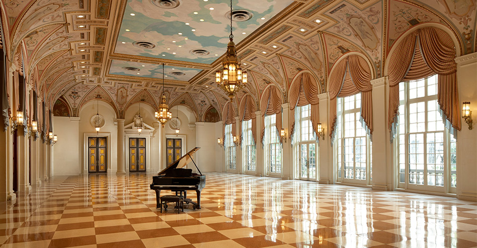 Black piano in a ballroom