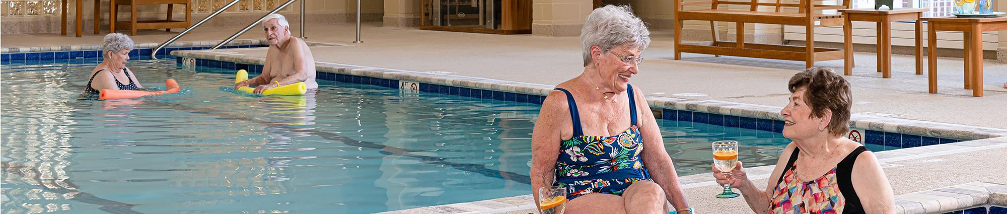 Senior adults enjoying a swim at The Chesapeake s indoor pool