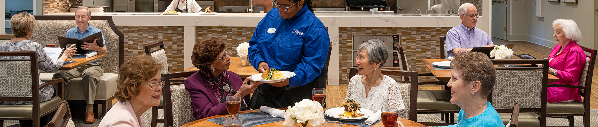 Senior residents at The Chesapeake eating in cafe area