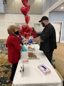 Senior Residents taking food samples from vendor at Heart Health Fair