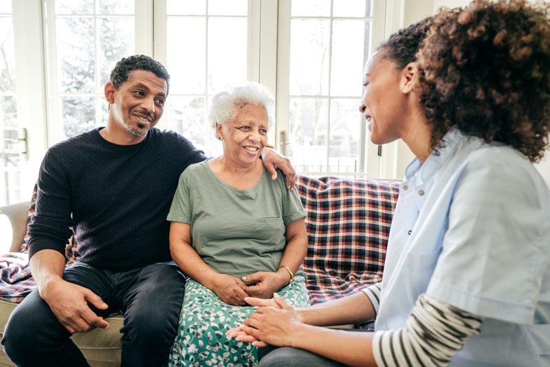 senior woman sitting with family