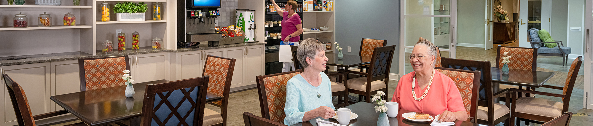 Senior adult women having breakfast in the cafe area at The Chesapeake