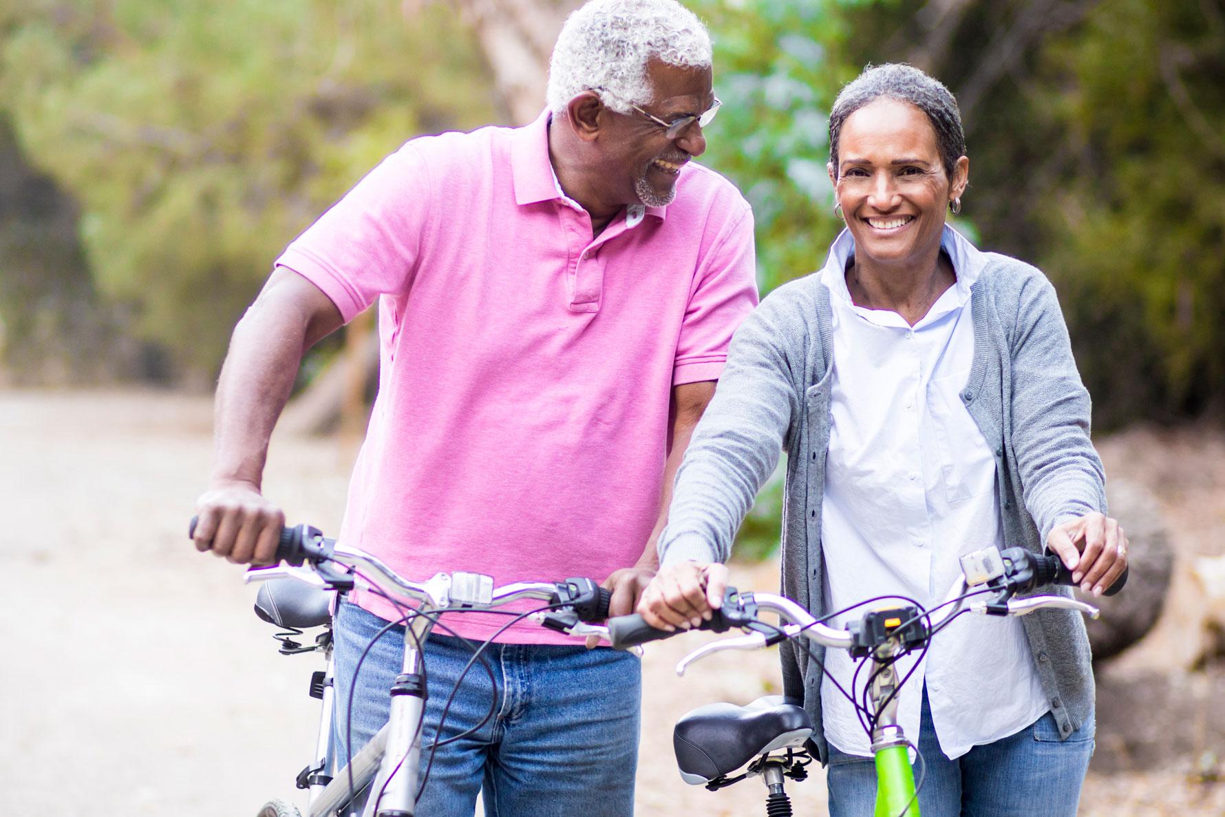 senior couple taking a bike ride