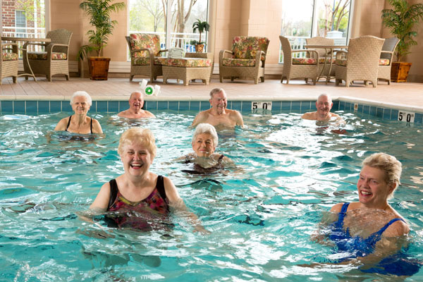 senior living community wellness activity at the swimming pool