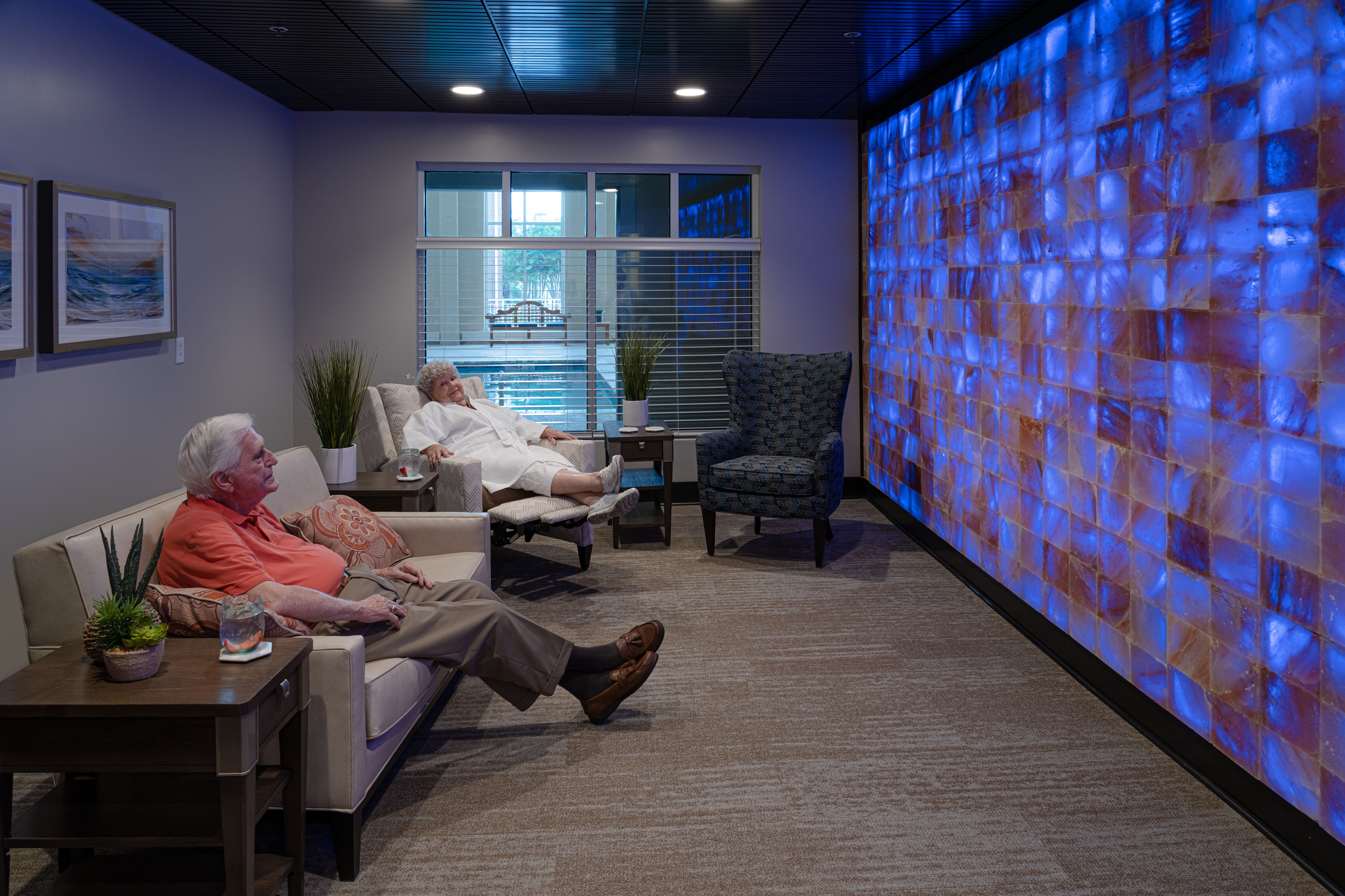 senior adult residents sitting in spa area at The Chesapeake