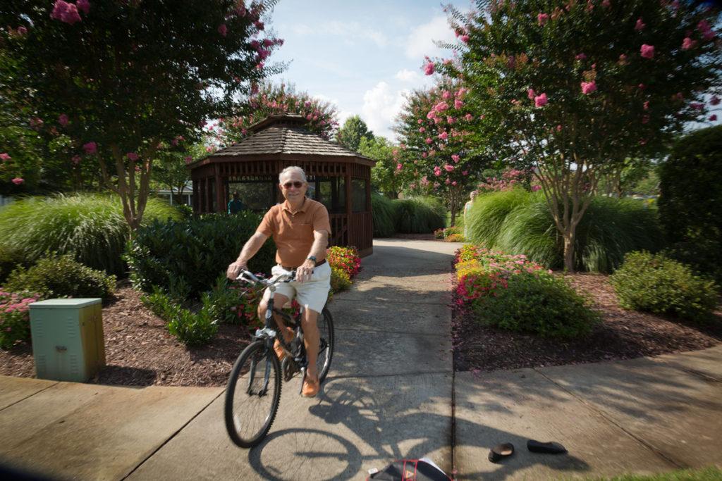 senior resident riding a bike
