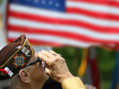 senior veteran resident saluting the flag