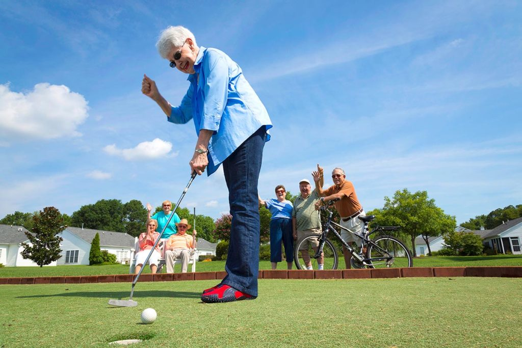 senior resident playing golf