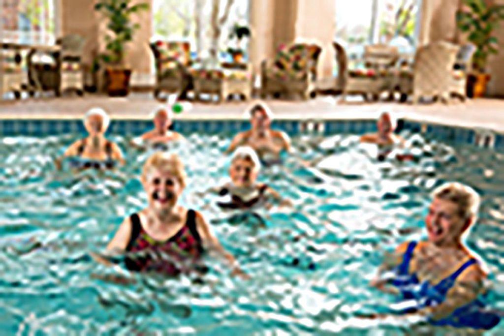 seniors water aerobics at the swimming pool