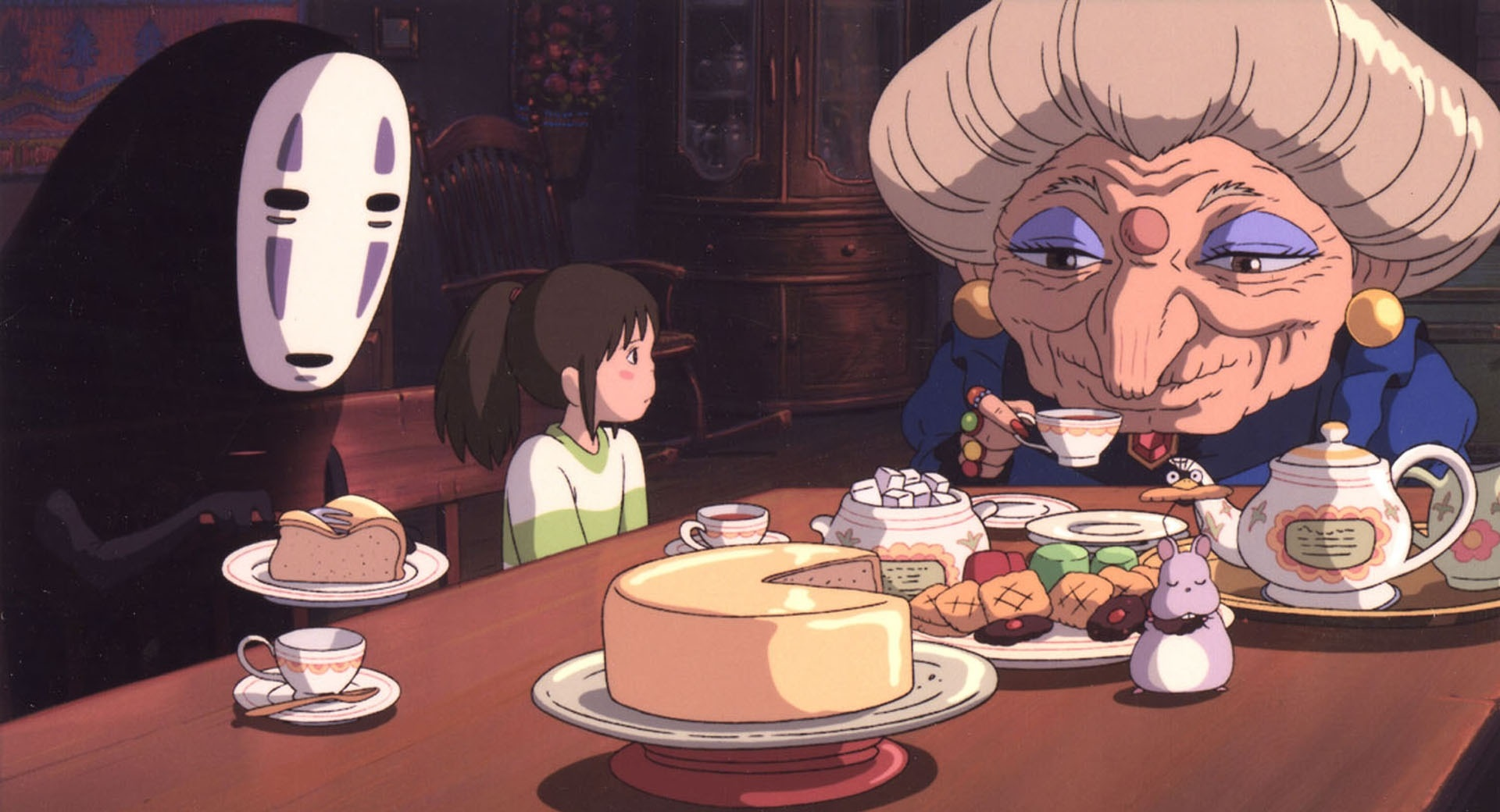 No Face, Chihiro, their transformed companions, and Zeniba enjoy their table of Ghibli Food.