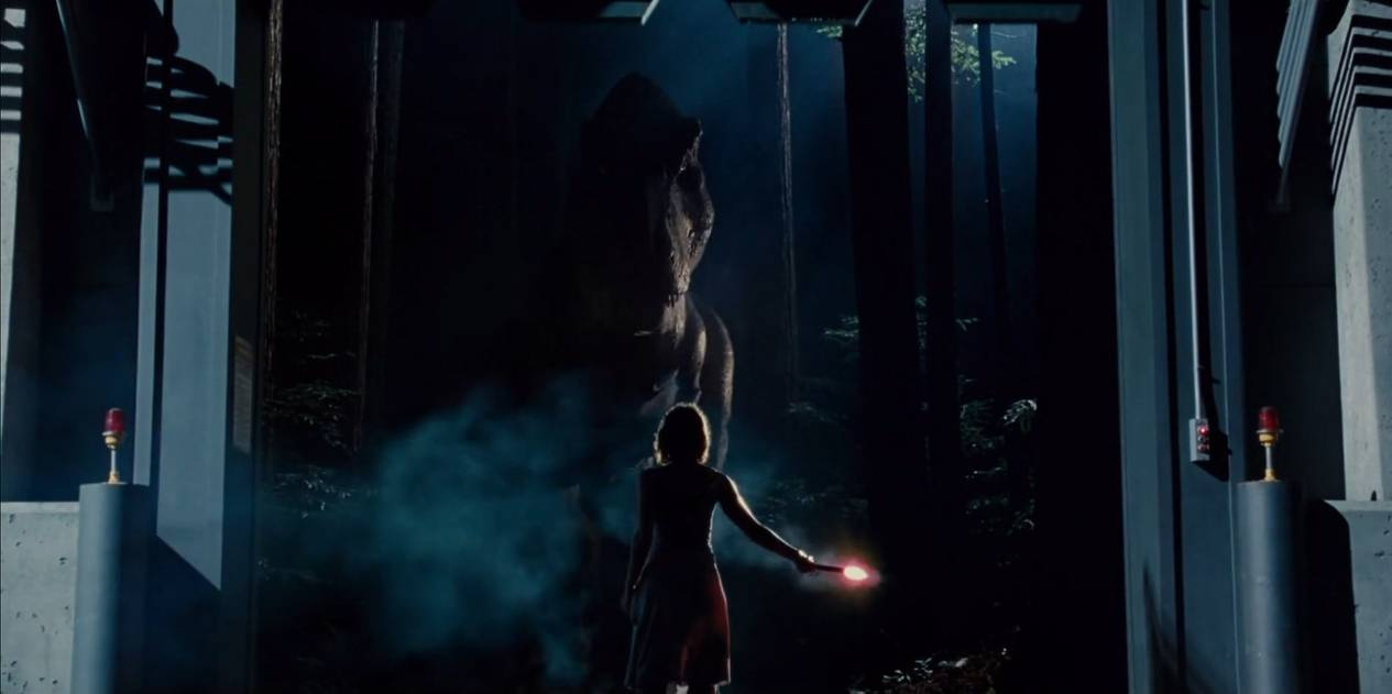 Claire luring out the T-Rex from its habitat with a flare similar to Malcolm in Jurassic Park.