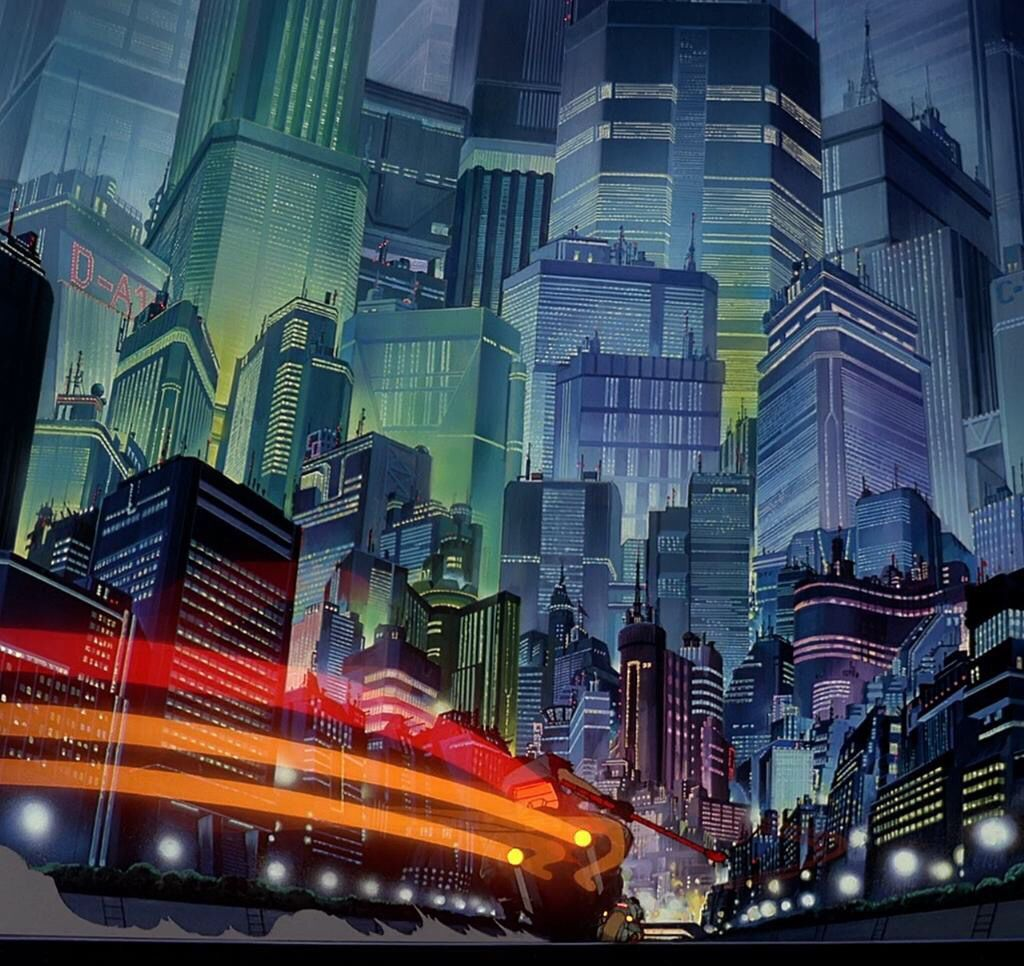 A motorcycle racing through the beautifully drawn buildings. The red and orange lights stream behind the bike. An example of the stunning animation in Akira.