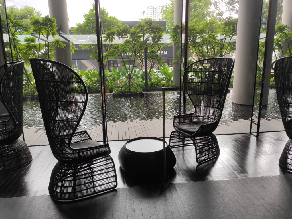 Parkroyal Collection Pickering: Hotel Lobby Lounging Chairs by Landscape Pool
