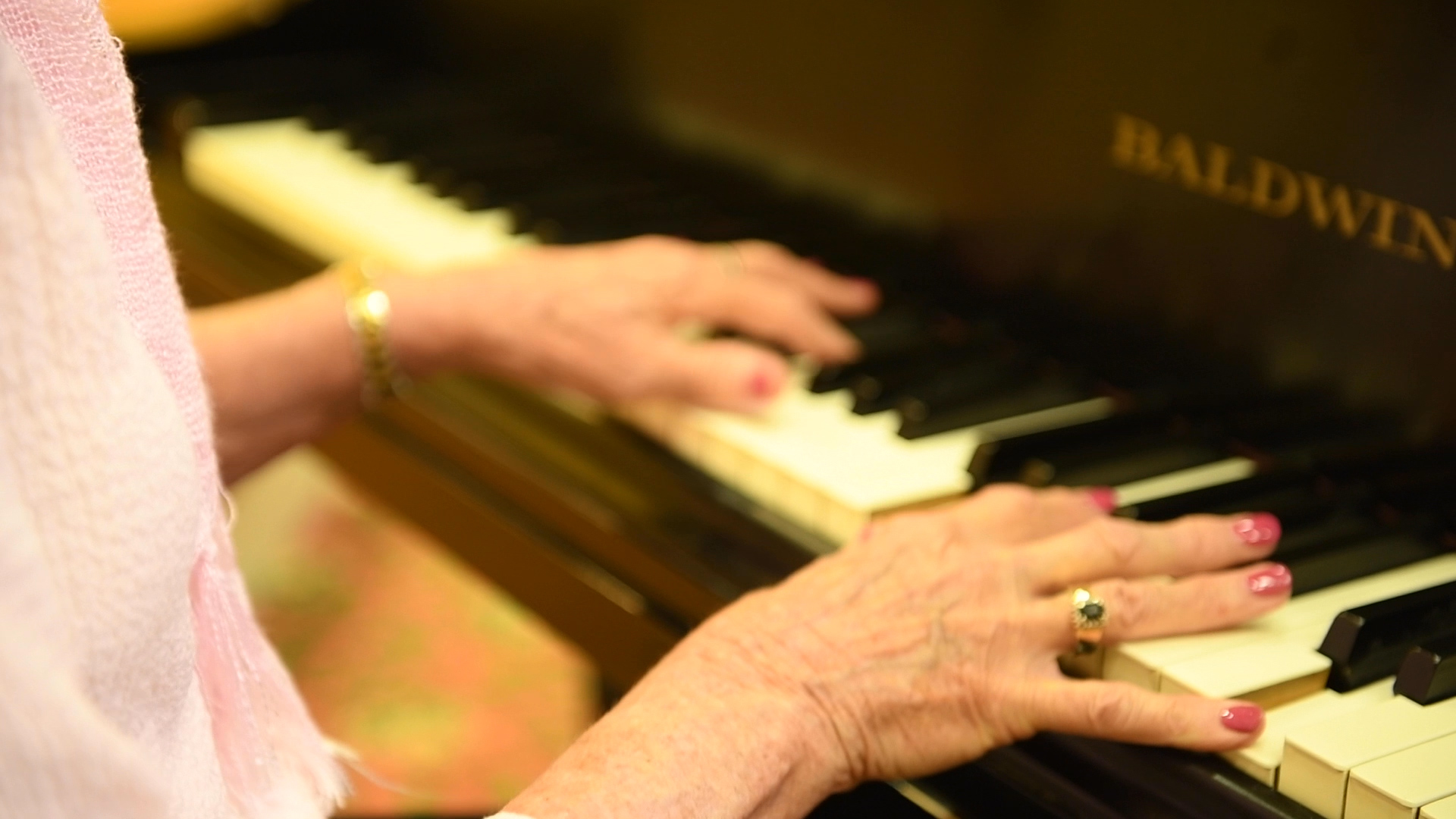 Elderly woman playing the piano