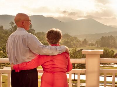 elderly couple enjoying the view from their senior apartment