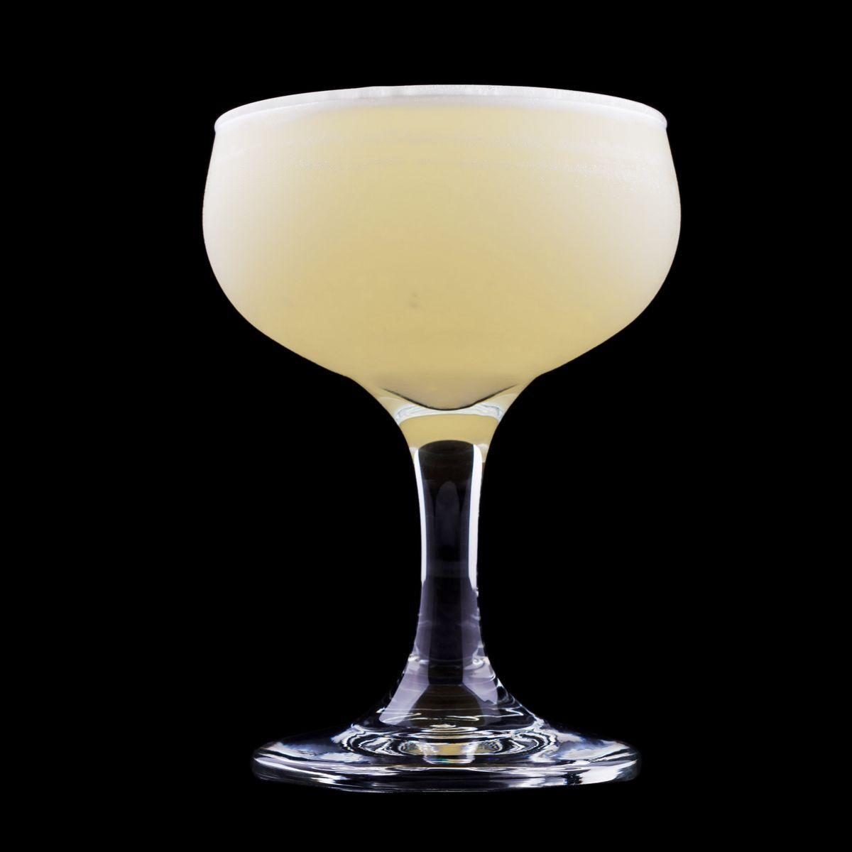 The White Lady is a classic cocktail that is made with gin, orange liqueur, fresh lemon juice, and optional egg white. It's in the sidecar family, made with gin instead of brandy. It was invented by world famous bartender Harry MacElhone in 1919, while he was working at London's Ciro's Club. It originally featured crème de menthe, triple sec, and lemon, but MacElhone revised his recipe in 1929, when he was tending bar at his own establishment, Harry's New York Bar in Paris. That new method called for gin, orange liqueur, lemon juice, and egg white, yielding a drier, more balanced version than the original.