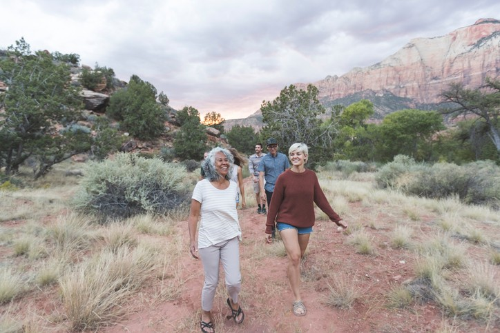 A group of seniors go for a day hike during the summer in the mountains