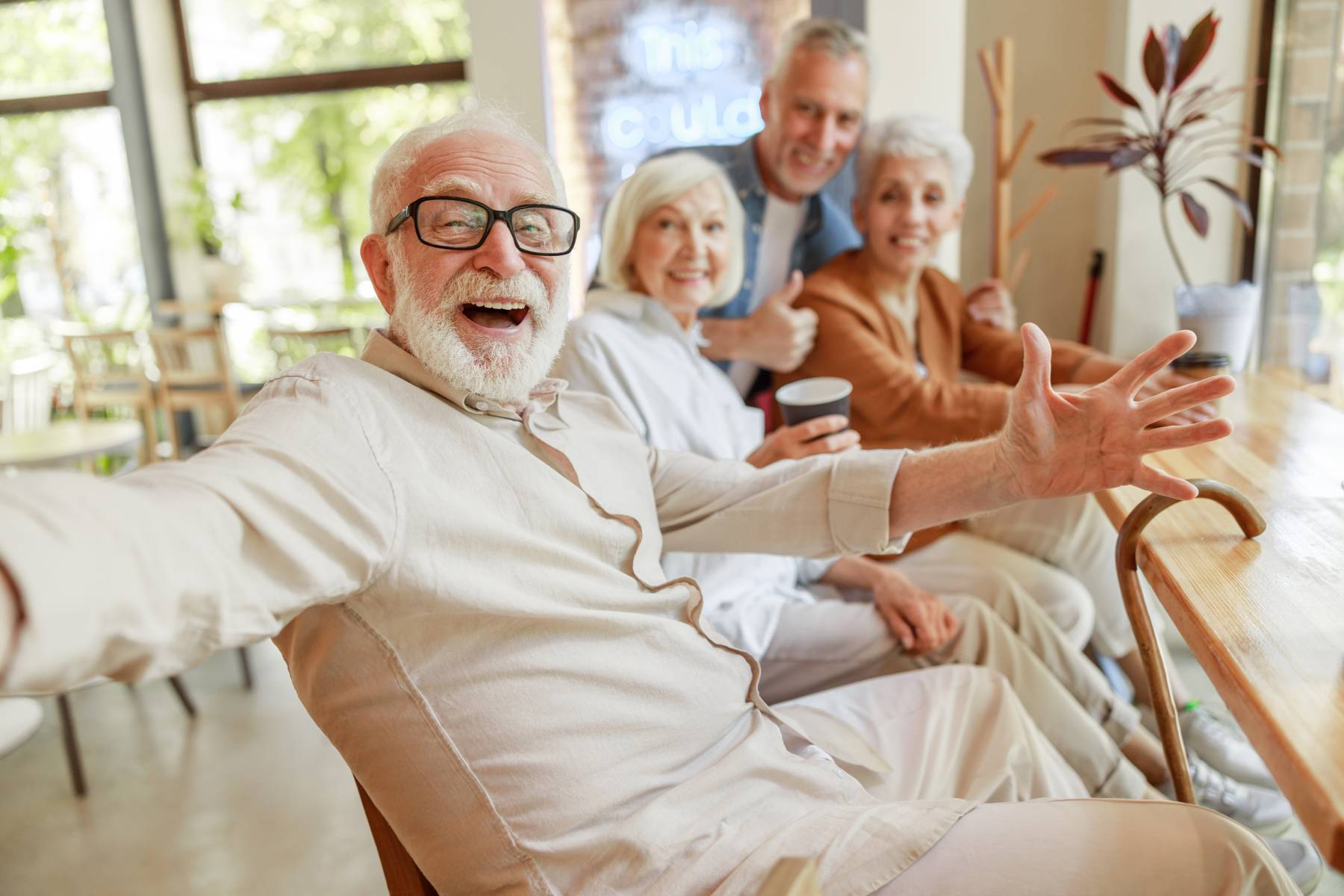 seniors socializing together while smiling and having fun