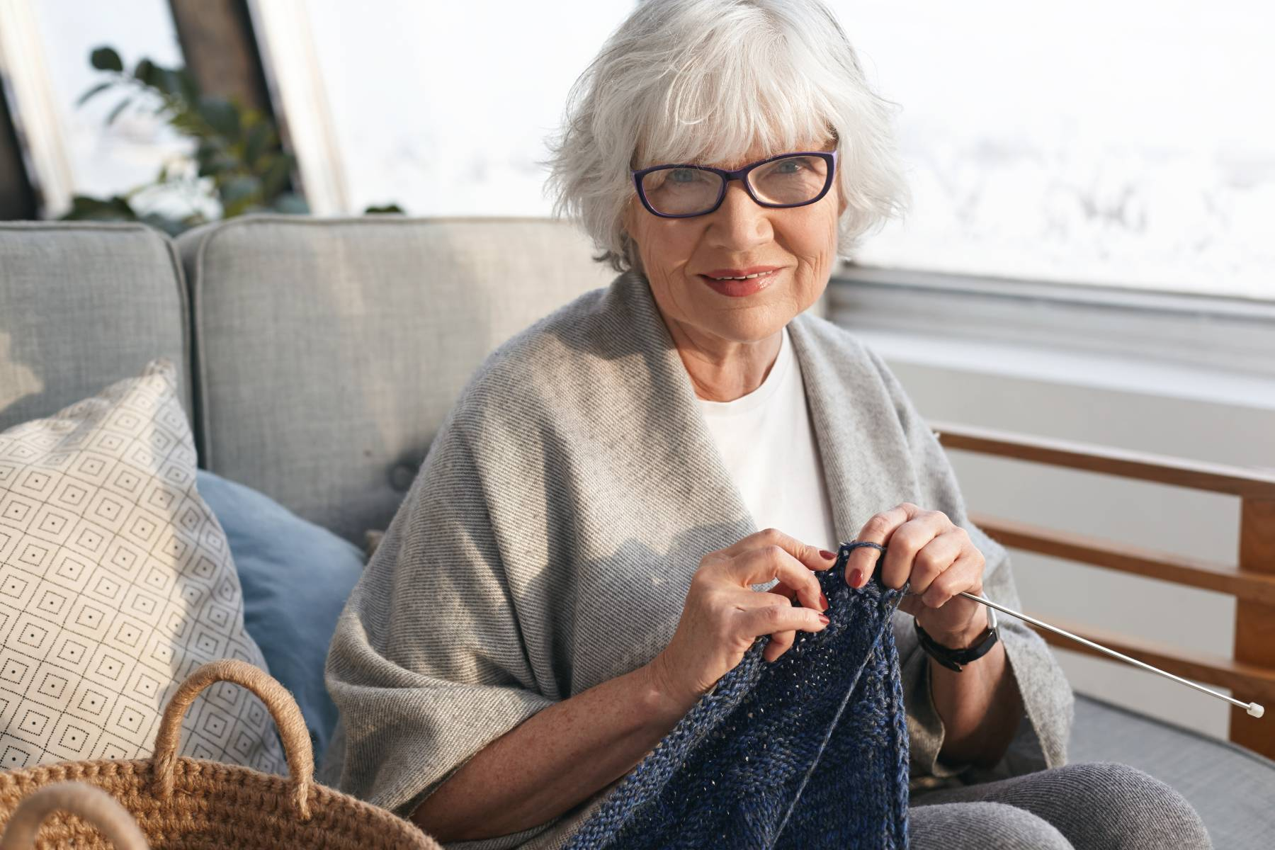 senior knitting in a senior apartment
