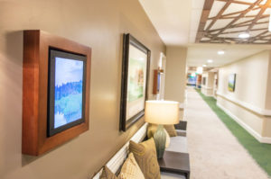 Memory care apartments have digital signs outside each room