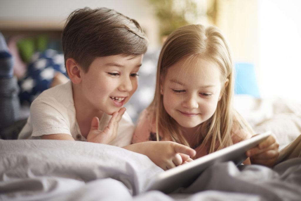 Siblings browsing a digital tablet