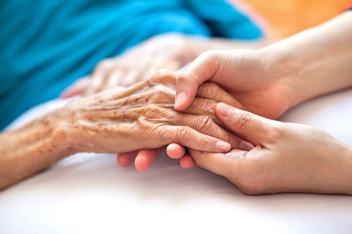 Seniors Hand Being Held by a Loved One