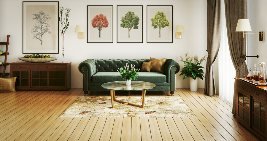 A dark green couch, modern coffee table, and life artwork motif in the living room