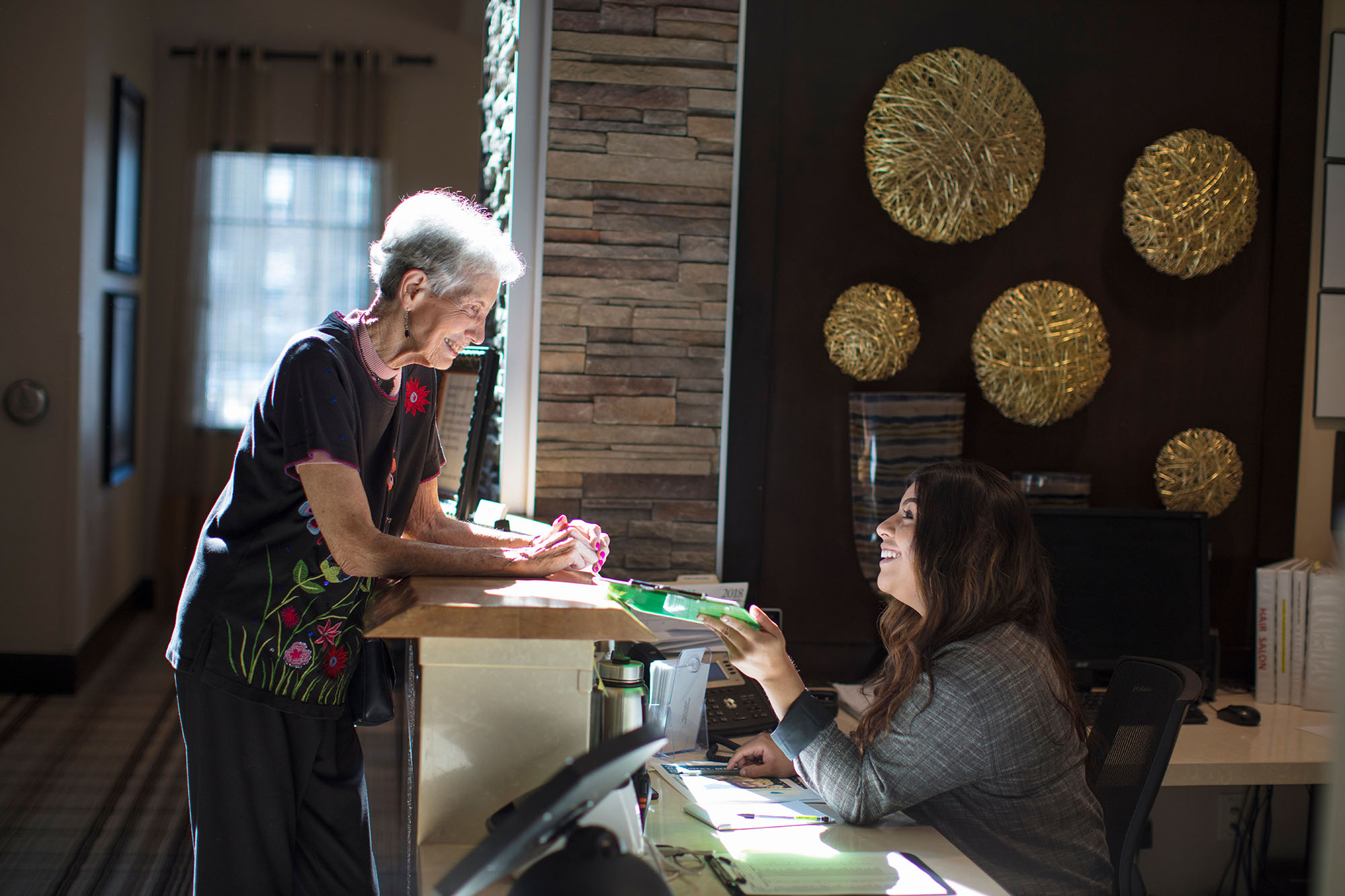 Resident getting help at the front desk