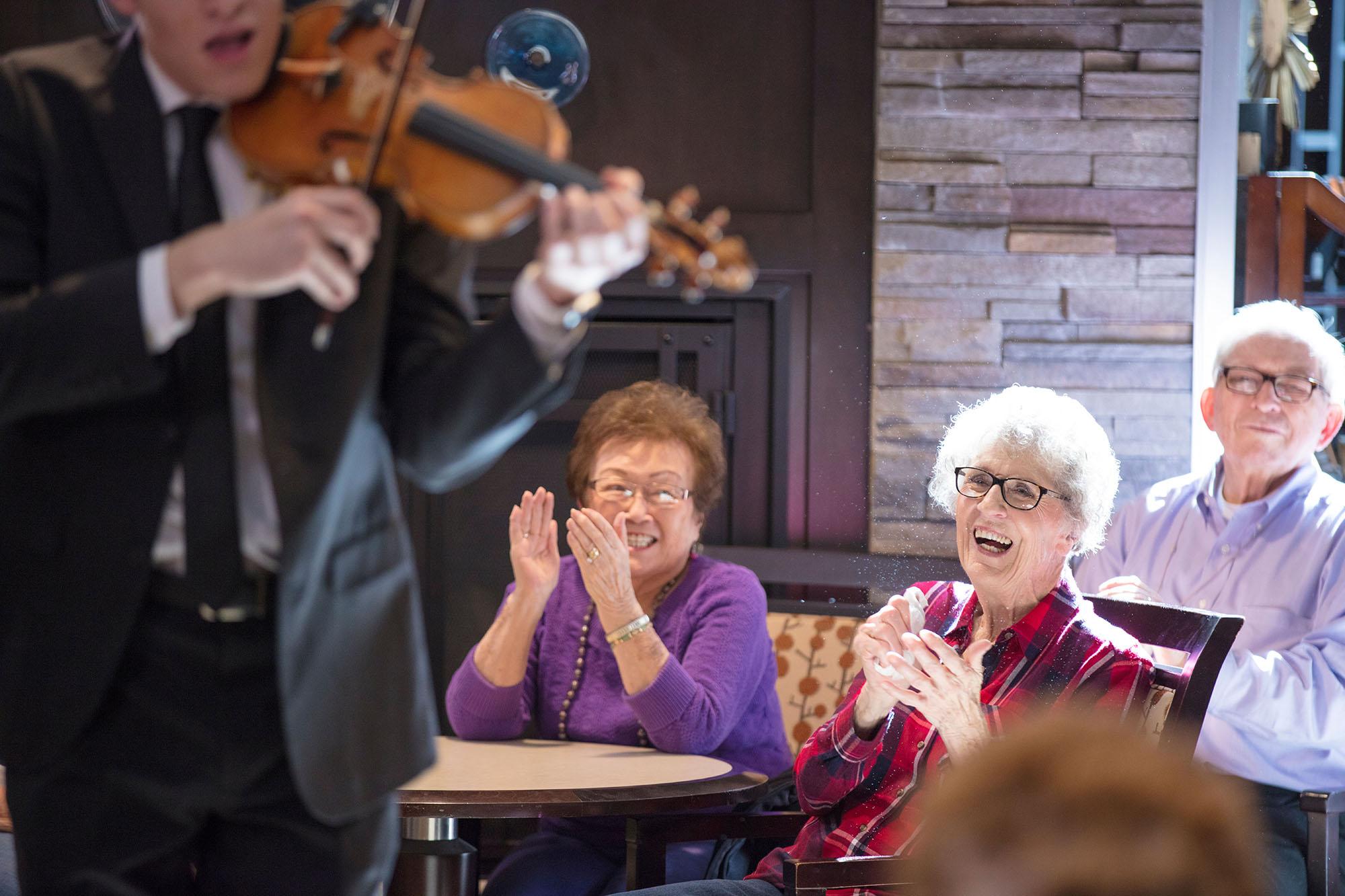 Residents enjoying a show