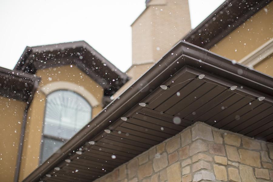 Snow falling outside of The Ridge Senior Living building.