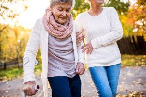 Two elderly women taking a walk outdoors