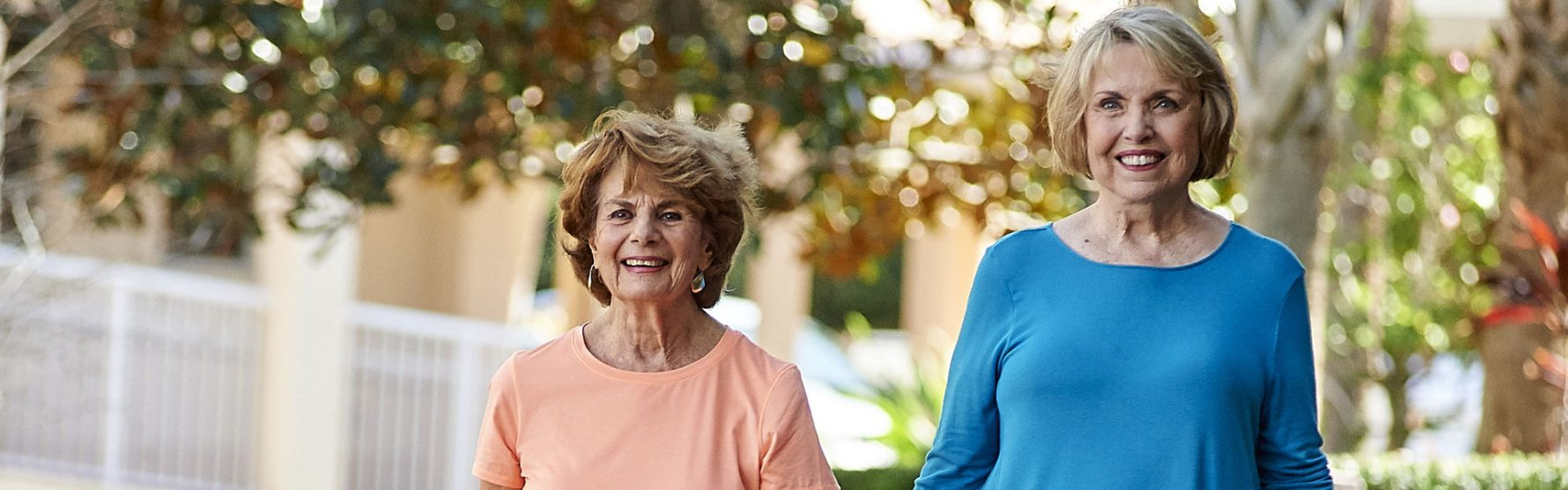 Two senior women walking outside